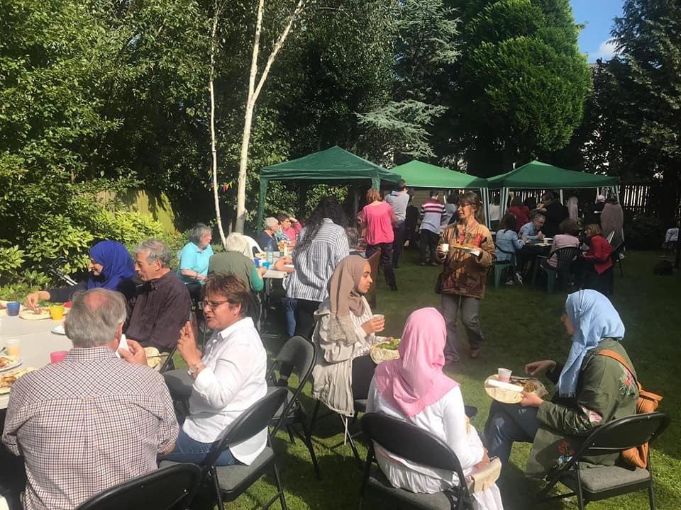 Guests Enjoying the Interfaith Barbecue